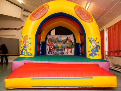 Bouncy castle Disco themed